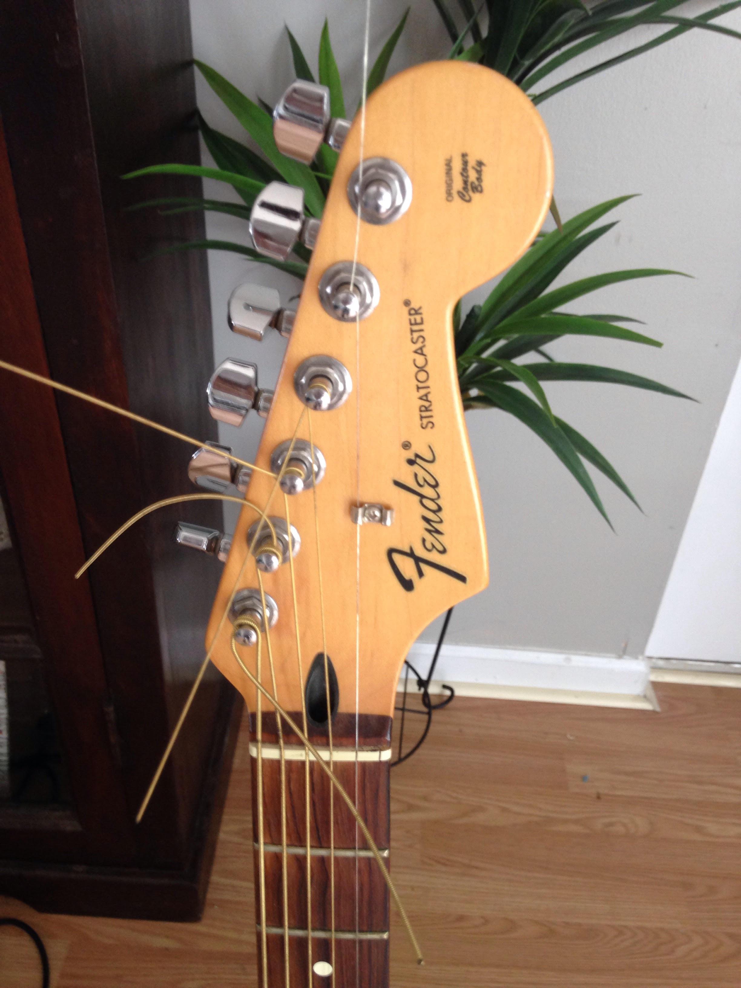 2009 Crimson Fender Stratocaster w/ Gig Bag